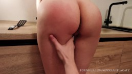 Dirty girlfriend spanked and fingered in the kitchen