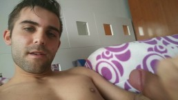 Handsome Spanish starts to masturbate with his nice cock