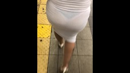 See through dress walking through crowded train station