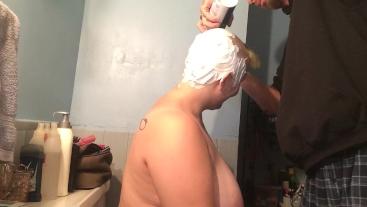 Bald girl getting reshaved