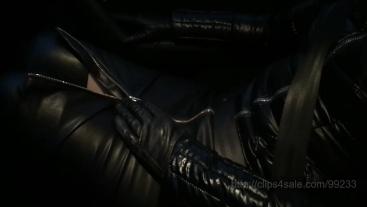 Shiny jacket, leather and seat belts
