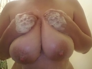Playing with big soapy tits