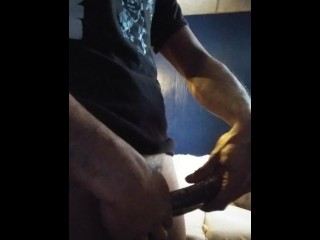 Jerking with a condom on