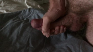 Stroking my cock slowly, cumming on the sheets