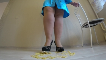 Fat legs in heeled shoes mercilessly trampled a banana. Crush Fetish.