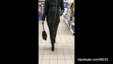 Shiny jacket, long leather skirt and overknee boots
