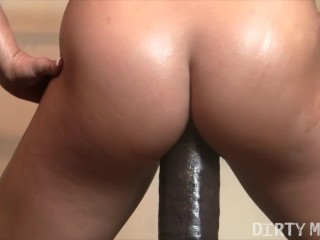 Female Muscle Porn Star Rides a Huge Dildo