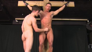 Straight Muscle Stud Hung From Cross and Jerked Off Until He Cums Gay BDSM