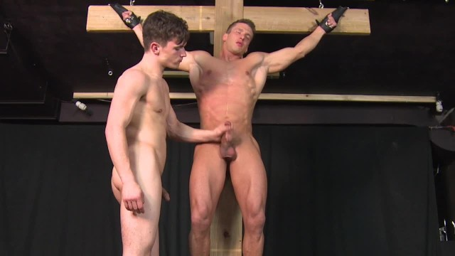 Bdsm gay pic Straight muscle stud hung from cross and jerked off until he cums gay bdsm