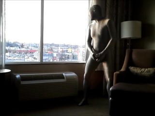 zentai croc is horny in the morning so shoots his load at hotel window