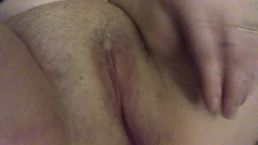 Quickly rubbing hairy pussy while husband is in room