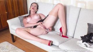 Brunette Milf strips off retro lingerie masturbates in nude nylons garters
