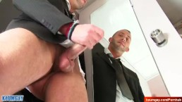 Salesman in suit gets wanked his big cock by us in spite of him
