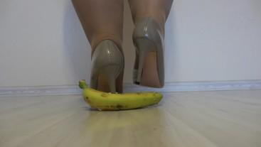 Fat legs in nylon mercilessly trample a banana sharp heels. Crush fetish.
