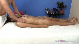 Little Asian girl receives oil massage