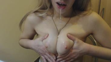 spit on my tits thinking it's cum