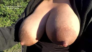 Quick public breast milk hand expressing lactating milk. Outdoors