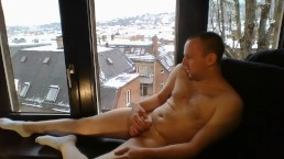 naked fapping in front of window and cumming with socks, snowy day