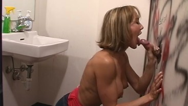 Brandi Love gives an amazing blowjob at the glory hole