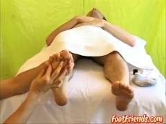 Long haired stud gets a passionate foot massage