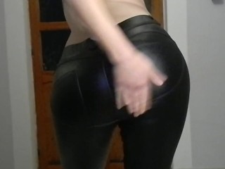 Big ass in shining leggings and spanking