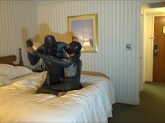 masked wetsuited guy shoots his load over defeated masked wetsuit enemy