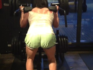 muscle girl pumping booty . Monster hack squat.