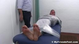 Bound muscular stud receives a tickling torment