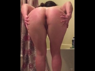Spying on Step Mom bending over to lotion her slut ass after her shower