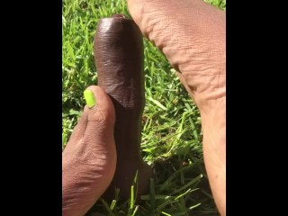 Singing toes on uncut dildo