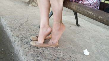 Dangling and shoeplay with flats in the park