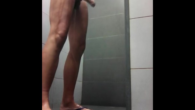 Sexy male sports athletes blog - In the locker room fitness club athlete washes in the shower