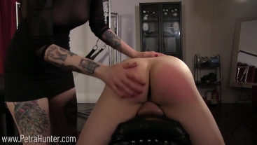 Slave punished with stern hand spanking