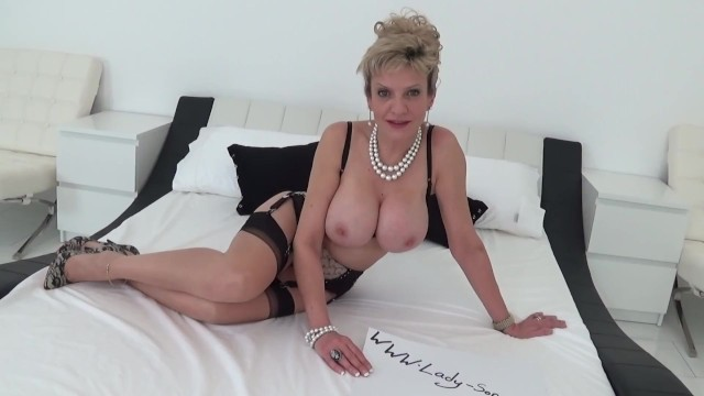 Lady Sonia undressing and teasing in her lingerie