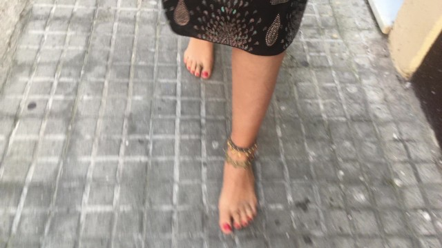 Barefoot toe teen free pics - Young female hippie is walking barefoot in public street