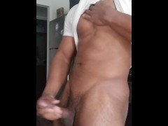 Black muscle hunk strokes a big dick