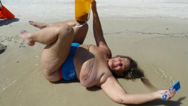Beach Boob Sand Castle (includes 97 photo musical slide show)