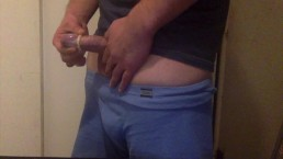 small uncut cock putting on a condom