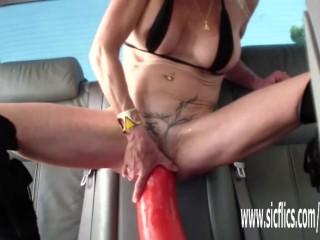 Fucking a gargantuan dildo in her wrecked pussy
