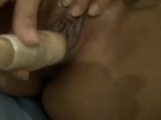 She plays with a lotion tube on her clit before she fucks herself!