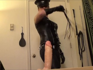 Dominatrix Whipping a Dildo