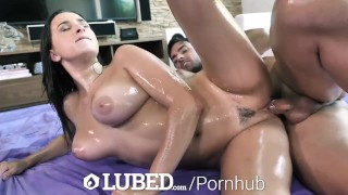 Screen Capture of Video Titled: LUBED BIG TIT FUCK with DEEP Creampie Penetration