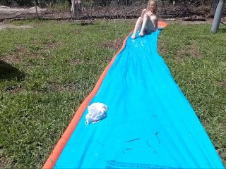 Blonde does Slip n Slide Naked in her backyard & masturbates
