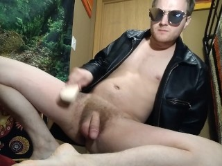 Hairy Guy in Leather Brushes his Balls and Ass