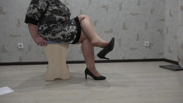 legs of a mature lady in nylon pantyhose and high heeled shoes