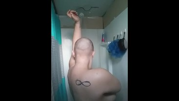 Bald girl in the shower