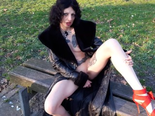 Slut masturbate with dildo in public park