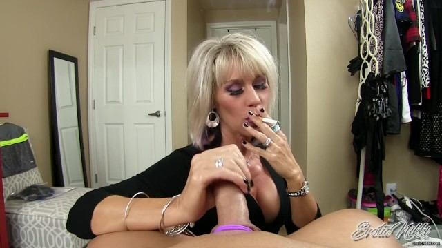 Erotic Nikki – Mature Sister in Law Smokes While Giving POV cuckold Handjob