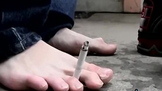Young punk presents his sexy feet while smoking