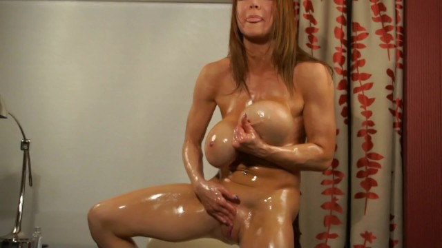 Busty red-haired woman in leather Busty bodybuilder oil bath